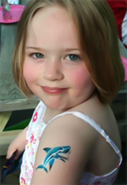 Child with an Air Brush Tattoo dolphin on her arm